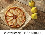 delicious pear tart on table | Shutterstock . vector #1114338818