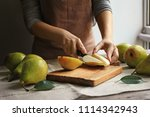 woman cutting ripe pears on... | Shutterstock . vector #1114342943
