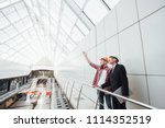 the worker shows the work done... | Shutterstock . vector #1114352519