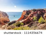 red rocks and blue sea on the... | Shutterstock . vector #1114356674