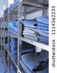 medical unform folded in stacks ...   Shutterstock . vector #1114362233