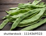 a pile of fresh green beans on... | Shutterstock . vector #1114369523