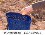 women's hand throws the... | Shutterstock . vector #1114389038