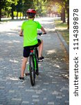 a boy on bicycle in the park | Shutterstock . vector #1114389878