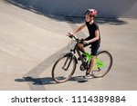 boy riding a bicycle in the... | Shutterstock . vector #1114389884