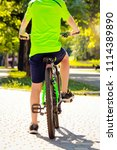 a boy on bicycle in the park | Shutterstock . vector #1114389890