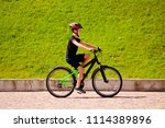 boy riding a bicycle in the park | Shutterstock . vector #1114389896