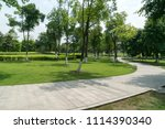 stone pathway in a lush green... | Shutterstock . vector #1114390340