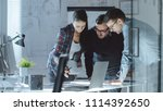 three design engineers have a... | Shutterstock . vector #1114392650