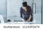 in bright modern office female... | Shutterstock . vector #1114392674