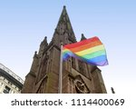 a rainbow flag on front of... | Shutterstock . vector #1114400069