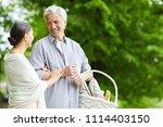 happy mature man with basket... | Shutterstock . vector #1114403150