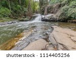 waterfall flowing through... | Shutterstock . vector #1114405256