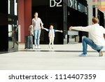 happy little girl running to... | Shutterstock . vector #1114407359