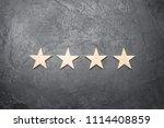 four stars on a dark background....   Shutterstock . vector #1114408859