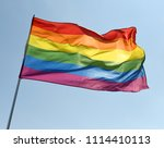 rainbow flag on blue sky | Shutterstock . vector #1114410113