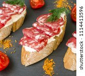fresh tasty salami sandwiches.... | Shutterstock . vector #1114413596