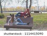 two happy cute beautiful female ... | Shutterstock . vector #1114415090