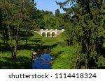 stone bridge and trees in ... | Shutterstock . vector #1114418324