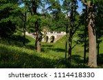 stone bridge and trees in ... | Shutterstock . vector #1114418330