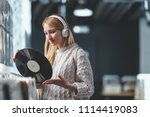 young girl with a vinyl record... | Shutterstock . vector #1114419083