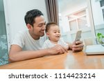 asian father and little son... | Shutterstock . vector #1114423214
