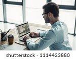 handsome interior designer in... | Shutterstock . vector #1114423880