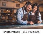smiling professionals in... | Shutterstock . vector #1114425326