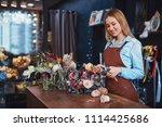 beautiful florist with bouquet... | Shutterstock . vector #1114425686