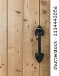 rustic wooden cottage door with ... | Shutterstock . vector #1114443056