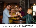 group of four people toasting... | Shutterstock . vector #1114457333