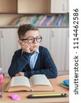 the boy in glasses and in... | Shutterstock . vector #1114462586