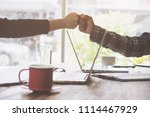 two business use hand to fist...   Shutterstock . vector #1114467929
