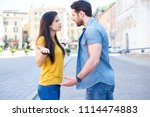 young couple arguing at the... | Shutterstock . vector #1114474883