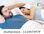 depressed young man lying in... | Shutterstock . vector #1114474979