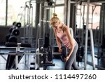 strong woman exercising with... | Shutterstock . vector #1114497260