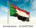 sudan flag on the blue sky with ... | Shutterstock . vector #1114497560