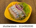 Stock photo sliced herring fillet with dill and onion 1114502030