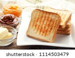 toast bread in plate with bowls ... | Shutterstock . vector #1114503479