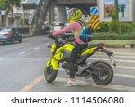 a lady motorcyclist in bangkok  ... | Shutterstock . vector #1114506080