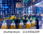 automatic filling machine pours ... | Shutterstock . vector #1114506209