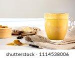 turmeric latte in glass mug... | Shutterstock . vector #1114538006