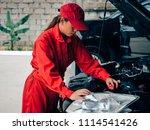 engineering asain woman fixing... | Shutterstock . vector #1114541426