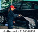 asain woman washing car. | Shutterstock . vector #1114542038