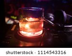 glass with whisky with ice cube ... | Shutterstock . vector #1114543316