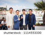 Small photo of CANNES, FRANCE - MAY 11, 2018: Actor Ji-Hoon Ju, actor Sung-min Lee, director Jong-bin Yoon and actor Jung-min Hwang attend the 'The Spy Gone North (Gongjak)' Photocall on 71st Cannes Film Festival