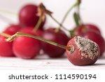 sweet rotten cherry on wooden... | Shutterstock . vector #1114590194