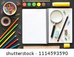 Back to School Concept with Stationery Supplies and Blackboard - stock photo