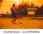 a fat boy playing soccer... | Shutterstock . vector #1114596836