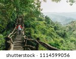 "Woman walk on wooden stair into forrest at ""Dakeng Hiking Trail"" Taichung, Taiwan, Beautiful scene of nature, Never give up and Way of life concept."